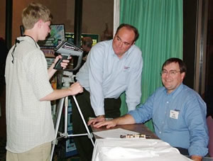Shay Edwards, left, confers with Chris Seffrin, center, and Jim Seffrin, right at IR/INFO 2006.